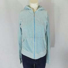 Juicy Couture Light Blue Velour Hoodie Classic Juicy Couture velour hoodie in light blue. Classic style with hood, long sleeves with ribbed cuffs, full front zip and large lower kangaroo pockets, with a ribbed hem. 80% cotton, 20% polyester. Made in the USA. Great condition; very minor overall wear and fading from wearing and washing- still looks great! No trades, no PP. Juicy Couture Tops Sweatshirts & Hoodies