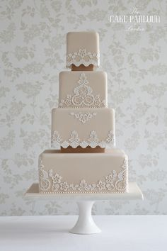 'VICTORIAN LACE' Wedding Cake - Thin textured appliqués and delicate piping over a four tier design inspired by Victorian lacework.