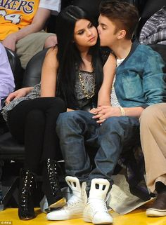 Rough ride: Justin and Selena Gomez, 21, - pictured together at a Laker basketball game in...