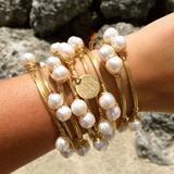 """Available in Gold or Silver Wire Bangle is 2.5""""D Fresh Water Pearls This listing includes 1 bangle with a Monogram Charm. Each Additional Pearl Bangle is $15. 9 Bangles are shown. Please make sure to enter the initials in the EXACT order that you would like them. Monograms are typically: First Name Initial, LAST Name Initial, Middle Name Initial. For example, Margaret Elizabeth Blake would be listed as MBE. We will not rearrange the letters. All Sales are Final. Please allow 3-4 weeks f..."""