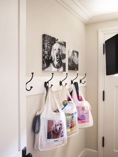 Reusable shopping bags from Shutterfly add a colorful fun element to this mud room and help keep things organized.