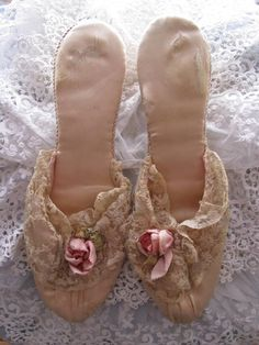 Beautiful worn lacy slippers from the early 20th Century.