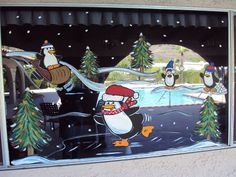 window painting of playful penguins for our winter wonderland party
