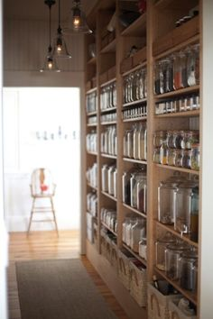 Beautiful bulk jar wall for a zero waste home. This would be a lovely pantry.