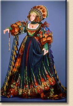 Autumn    Inspired by some of the gowns in James Christensen's illustrations, this figure represents the transition of late summer into fall. The dark greens of late summer are taken over by the brilliant hues of autumn.