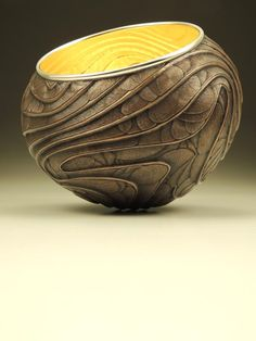 """Luminous Relic 1331 by David Huang. This vessel was formed through traditional angle raising techniques and further embellished with chasing techniques. The approximate size is 5.25"""" x 6.75"""" x 6.75"""". It is made of copper, sterling silver, and 23-karat gold leaf."""