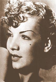 Carmen Miranda 1930. Love the hair the eyes the everything!