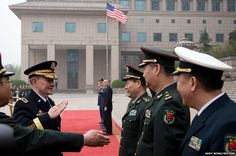 Gen Martin Dempsey, chairman of the US Joint Chiefs of Staff, salutes as he is introduced to Chinese military officials by chief of the general staff of Chinas Peoples Liberation Army, Fang Fenghui, upon his arrival at the Bayi Building in Beijing.