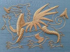 RSN ( Royal School of Needlework) Future Tutor Kate Barlow's Goldwork, Dragon. Beautiful golden dragon stitches