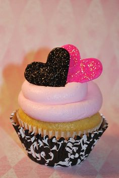 Cupcake with edible cookie hearts on top!  Valentines anyone?