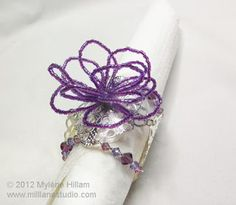 String beading wire with delica beads and form it into this delicate and airy flower napkin ring.