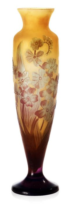 Émile Gallé | Eggplant colored overlay with cut and etched floral decoration on a yellow Fund. Signed Gallé on life.
