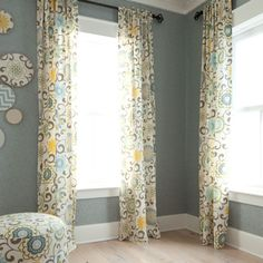 Fabric circles on wall. Easy (?) and inexpensive. Project Nursery - Custom Floral Nursery Drapes from Carousel Designs