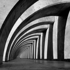 repetition-This building has arches that repeat down the hall. The shadows also are repeated from the arches.