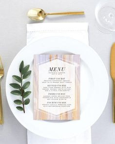 Dinner menu from the Beatrice wedding invitation suite by Margaux Paperie. This menu features pretty agate artwork in blush pink, purple, lilac, peach, and white. Modern fonts in black on a transparent white background describe your delicious meal. Perfect for your modern bohemian wedding reception tables!