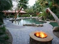 This raised fire pit next to a lagoon-shaped pool sets a welcome scene for evening entertaining.
