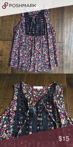 EUC floral and crochet tank with tie at neck. Med Cute flowy top. Goes great with white pants! Excellent condition 100% rayon. Socialite Tops