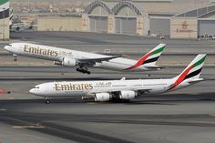Emirates Airbus taxiing at Dubai while a company Boeing departs on the adjacent runway (photo by Sam Chui) Emirates Airbus, Emirates Airline, Best Airlines, Boeing 777, Commercial Aircraft, Civil Aviation, Aeroplanes, Private Jet, Air Travel