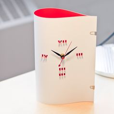 'shadow clock, red' designed by anne thomas for toma objects