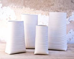 porcelain vases collection with stripes relief. hand built ceramic containers by Ady Shapira (Wapa Studio).