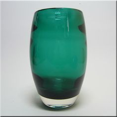Whitefriars sea green glass ovoid vase with internal horizontal optical ribbing, designed by Geoffrey Baxter, pattern number 9587.