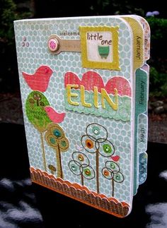 Mini album for babies first year (or any year for that fact) tabbed out with months