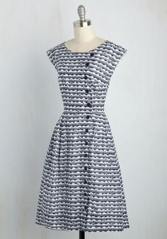 Highlight the allure of your personality with this navy and white dress from Emily and Fin! It's said that you shouldn't judge a book by its cover, but when you're clad in the short dolman sleeves, lighthouse print, and bevvy of buttons this pocketed midi offers, others can't help but want to know all about you!