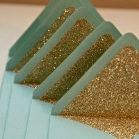 wedding invites? Maybe not gold, but I love the glitter!
