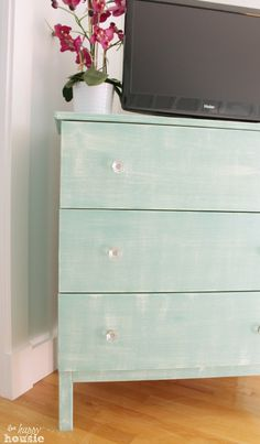 IKEA Tarva Dresser Hack with faux Linen Texture with country chic paint colors in Refreshed ( mint) and Bliss (turquoise,teal)