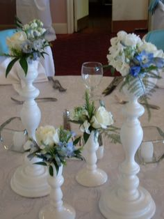 Candlesticks with roses, stock and delphinium