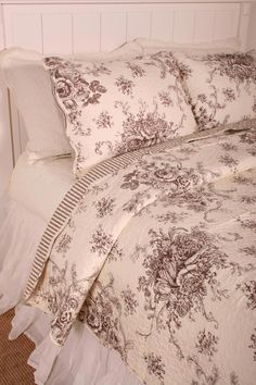 A classic beauty fresh from a country garden. The floral toile pattern is subtle and perfectly scaled. Soft and inviting in a cotton look microfiber with cotton fill. This French Country style quilt features a classic brown floral toile on ivory background and reverses to a coordinating stripe.