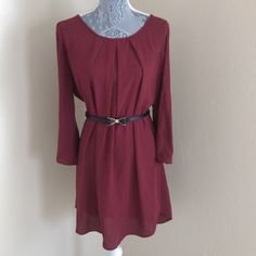 Cutout Tunic / Dress NWOT This chic and minimalistic wine colored tunic dress features a cutout back, three quarter sleeves, and an adorable black bow belt (which can be worn with any outfit to add some charm). Wear this as a dress or with leggings. New without tags boutique . 100% polyester, semi-sheer. ⚡️ Price Firm Dresses
