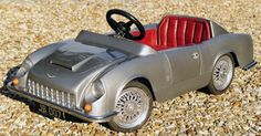 """Lot No: 172, meanwhile is """"A rare 007-Up promotional Aston Martin Vanquish pedal car."""" Description from daddytypes.com. I searched for this on bing.com/images"""
