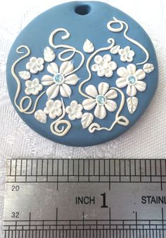 Polymer clay pendant, handmade with applique technique, one of a kind. Light blue with white flowers, leaves and swirls and light blue crystals. By Lis Shteindel. Fimo Polymer Clay, Polymer Clay Flowers, Polymer Clay Pendant, Polymer Clay Projects, Polymer Clay Creations, Polymer Clay Earrings, Clay Beads, Porcelain Clay, Ceramic Clay