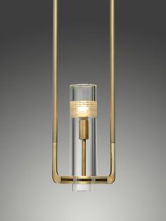 The Chamont Lavalier is machined by hand from solid brass. The round rods of the two arms transform seamlessly into its square spine at each corner. A lead crystal cylinder, with hand carved details, sits along the spine. Ceiling Fixtures, Ceiling Lamp, Light Fixtures, Cool Lighting, Lighting Design, Lighting Ideas, Pendant Chandelier, Chandelier Lighting, Lamp Light
