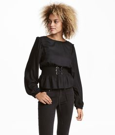 Blouse in subtly-patterned woven fabric with smocking and lacing at waist. Long, wide sleeves with a flounce at shoulders and elasticized cuffs