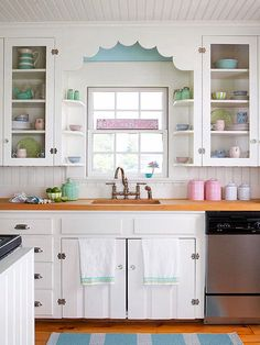 White Cabinets with vintage-inspired hardware, sweet pastels and wood details for the ultimate in Cottage Style.