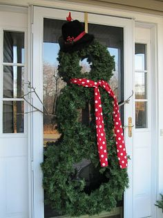 how to make a snowman wreath...what a cool idea, use green cable ties to connect 3 different size wreaths to make the snowman!