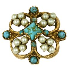 Chanel Renaissance Quatrefoil Brooch | From a unique collection of vintage brooches at https://www.1stdibs.com/jewelry/brooches/brooches/