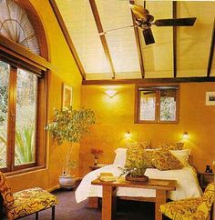 A mud brick wall rendered to give a smooth finish and painted with a natural clay slurry. [Love this interior. Love the elegance of the smooth render and the arched window.]