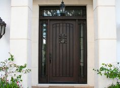 Jeld-Wen Wood Jeld-wen Custom Fiberglass Door with clavos and speakeasy.