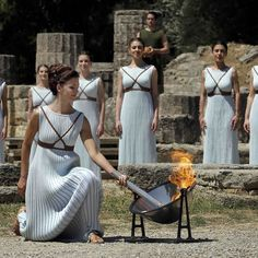 21 APR: The flame for the Olympic Games in Brazil has been lit in southern Greece. The ritual was established 80 years ago for the Berlin Games based on a ceremony in Ancient Olympia where games were held for more than 1000 years. Actor Katerina Lehou who lit the torch offered a mock prayer to Apollo the old Greek god of light and music at Thursday's ceremony. Wearing a long pleated robe she knelt solemnly to the ground and lit the torch within a few seconds by using a concave mirror to…