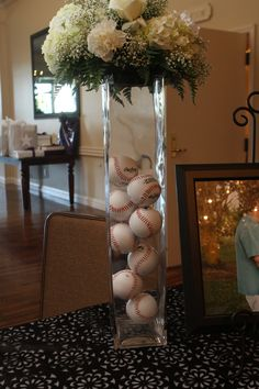 Baseball wedding.... Its a compromise between the traditional flower centerpiece and adding the baseball wedding idea.