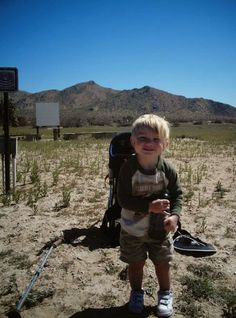 """Putting on gear during a day hike with kids. Read more tips for day hiking with children in """"Hikes with Tykes: A Practical Guide to Day Hiking with Kids."""""""