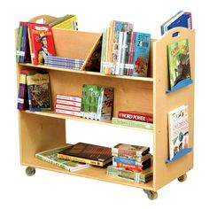 The Guidecraft School Library Cart is perfect for classroom or library use. It comes in a Baltic birch construction with heavy duty casters and hand-hold cut-outs. The Guidecraft School Library Cart shelves are organized in an orderly manner in that the t Library Cart, Library Ideas, Kids Library, Dream Library, Kids Playroom Furniture, Children Furniture, Library Organization, Organization Station, Classroom Organisation