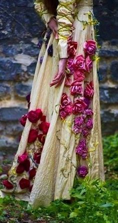 Clothing:  Gown and roses.