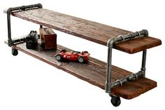 """Woodiron TV Stand - iThis TV stand is made from salvaged metal pipe and wood. It is strong enough to support even large televisions, and heavy-duty casters make moving it easy. Specifications  Width 46""""; Depth 16""""; Height 20"""" ; Materials Reclaimed wood and Black pipe"""