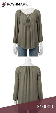 Coming soon medium Product Details Wear this juniors' Mudd peasant top with your favorite jeans for a fashionable, easy look.  PRODUCT FEATURES Tasseled tie scoopneck 3/4-length sleeves Elastic cuffs FABRIC & CARE Rayon Machine wash Tops