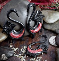 Black horn tribal swan design with red jasper inlays
