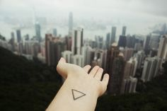 triangle tattoo | Tumblr  This has got to be the most waste of time and money. A triangle?? Really??